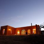 Evening glow from the rammed earth Villa
